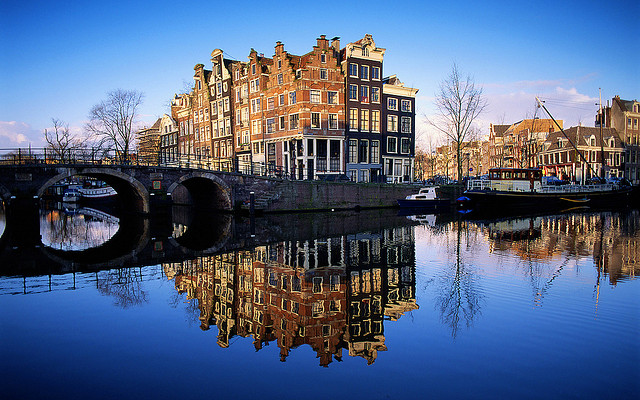 Amsterdam - with its beautiful canals, charming Dutch Houses, The Royal Dam Palace, Rijkmuseum and diamond cutting centres.