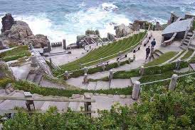 Witness the Minack Theatre, Cornwall's world famous open-air theatre, constructed above a gully with a rocky granite outcrop jutting into the sea