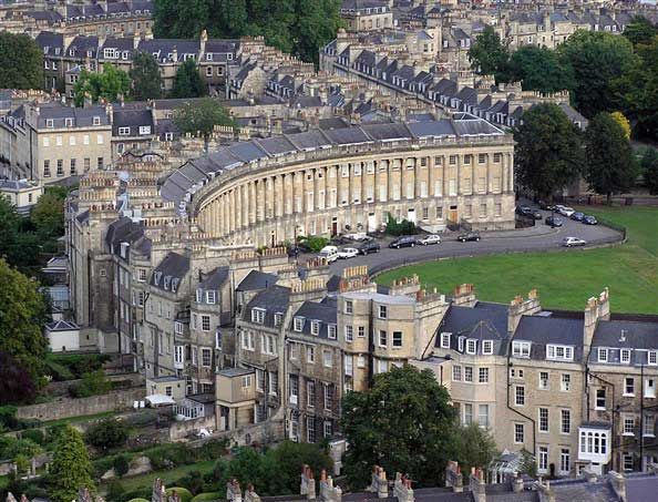 See the Royal Crescent, a row of 30 terraced houses laid out in a sweeping crescent
