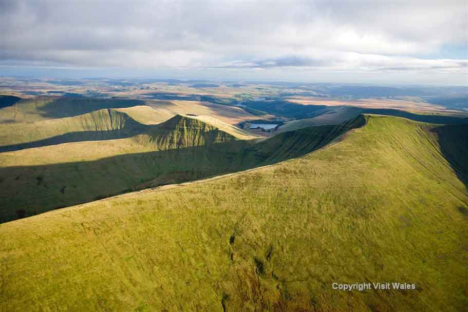 Cross the Brecon Beacons National Park home to waterfalls, forests and market towns