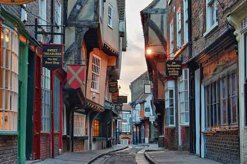 Admire York, renowned for its exquisite architecture, tangle of quaint cobbled streets and iconic York Minster
