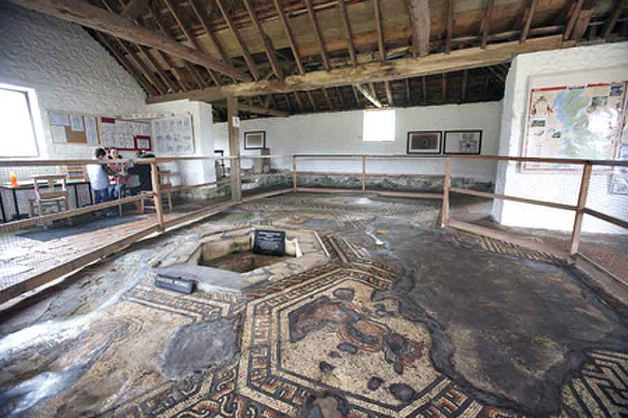 Visit Bignor Roman Villa, a large excavated Roman courtyard villa - well known for its high quality mosaic floors