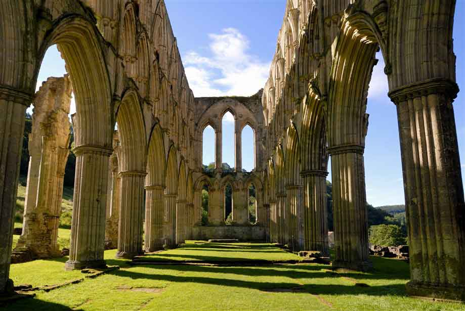 Marvel at the extensive remains of Rievaulx Abbey in its dramatic setting