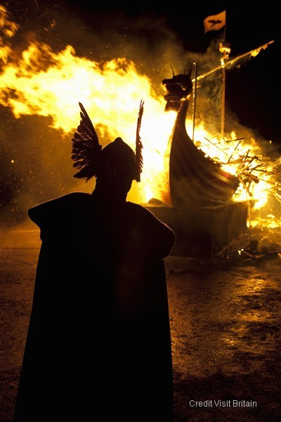 Festival of Up Helly Aa - an annual community event culminating in a thousand person torch-lit procession and the burning of a galley
